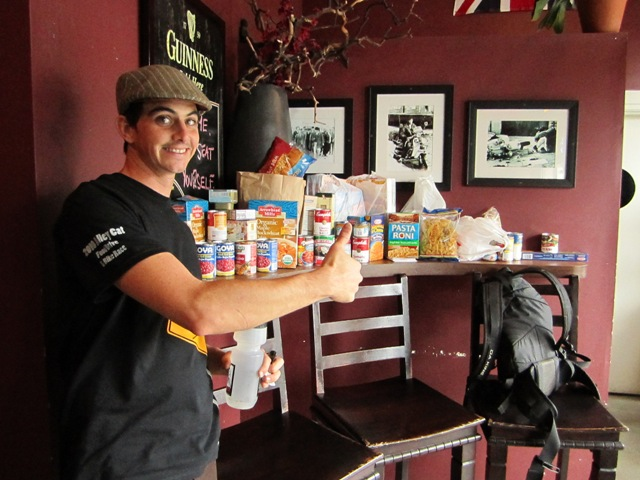Alley Cat Race- Kelly Cowan displays food to go to R.E.F.B.
