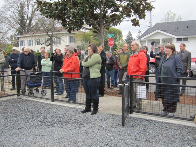 Onlookers watch the plaque unveiled