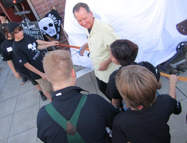 John Sawyer cuts ribbon