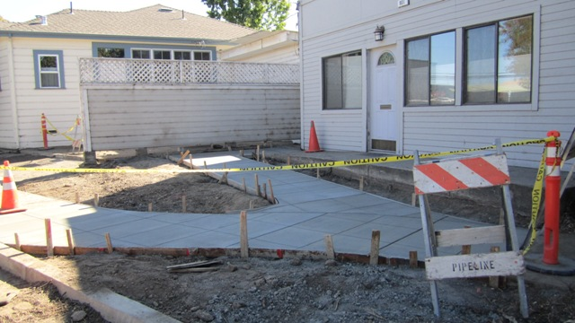 New sidewalk and ramp on Donahue Street