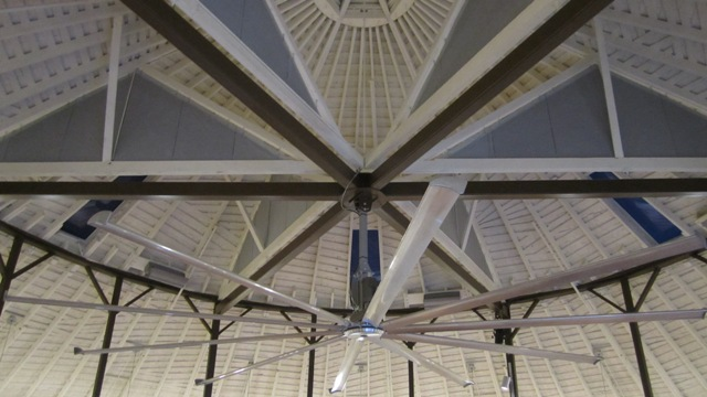 A fan helps regulate the barn\'s temperature