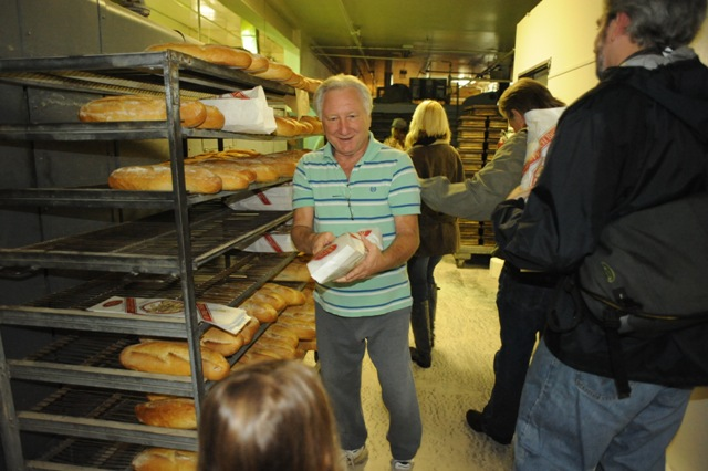 Robert hands a fresh, warm loaf to everybody on the tour By B. Rosales