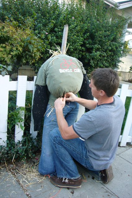 Brooks creates a Bike Czar Scarecrow