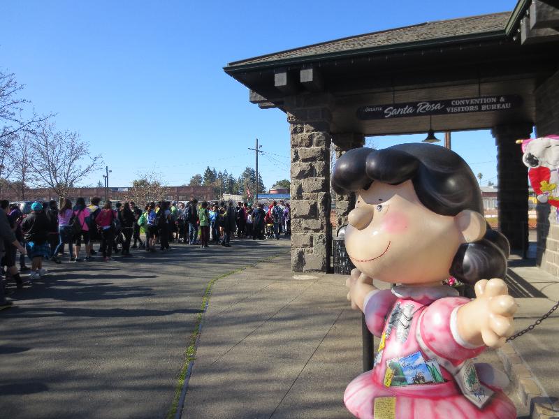 A school group tours RR Square