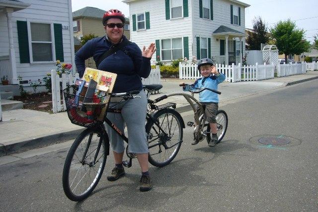 Rachel & Remy ride their bike