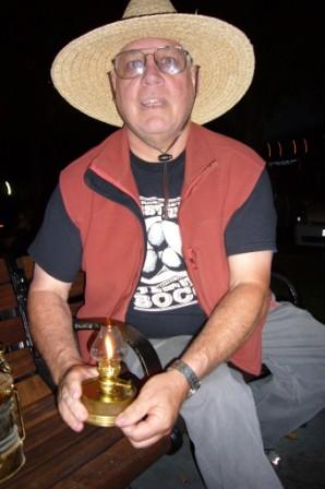 Guy lighting his lantern