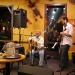 Ken Risling and son Avery Risling-Sholl perform at Aroma Roasters