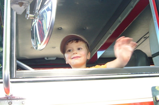 Evan loves the fire truck