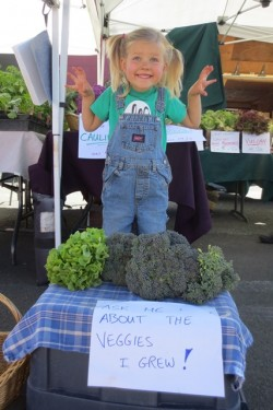 A Mini Farmer (Singing Frogs Farm) at the West End Farmers Market